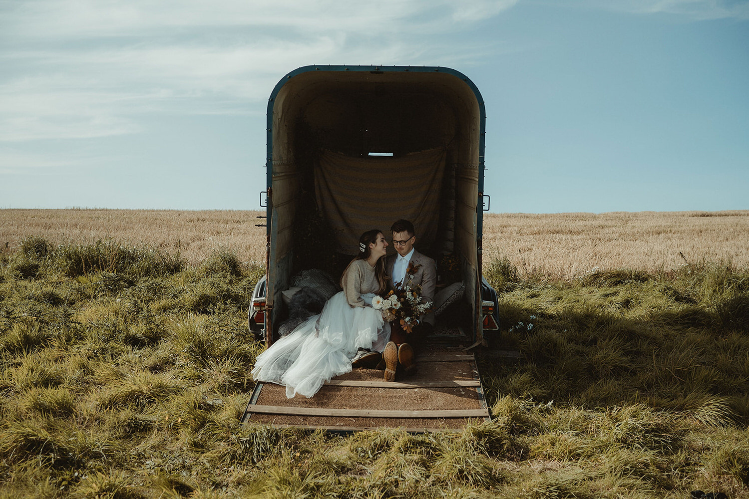 Just Married horsebox sign and seating area for seaside clifftop elopement on the East Coast of Scotland at the Cow Shed
