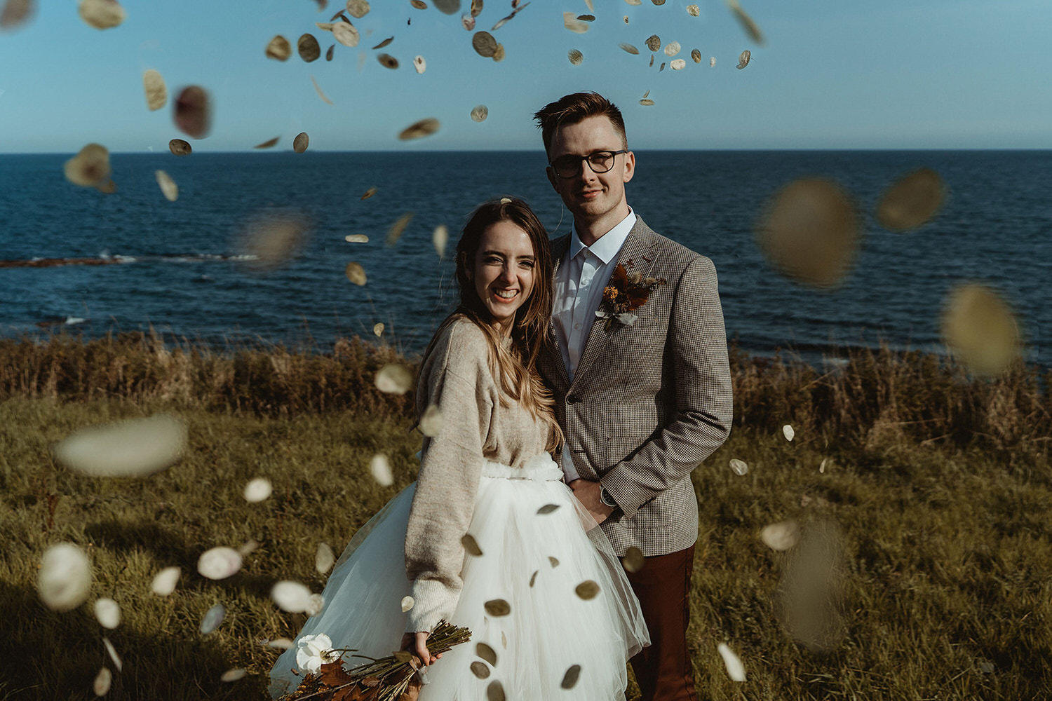 Natural sustainable confetti at clifftop seaside elopement on the East Coast of Scotland