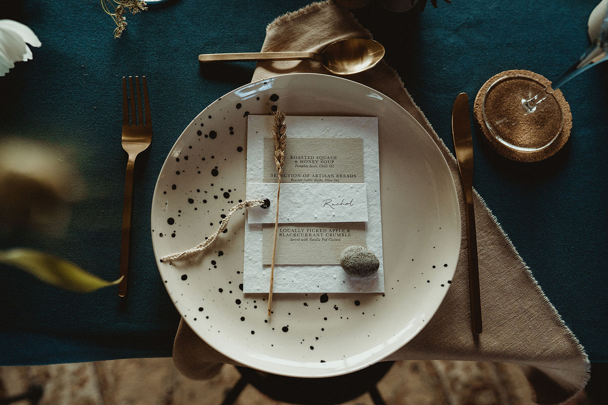 Speckled dinner plate with stone and dried grasses wedding table styling