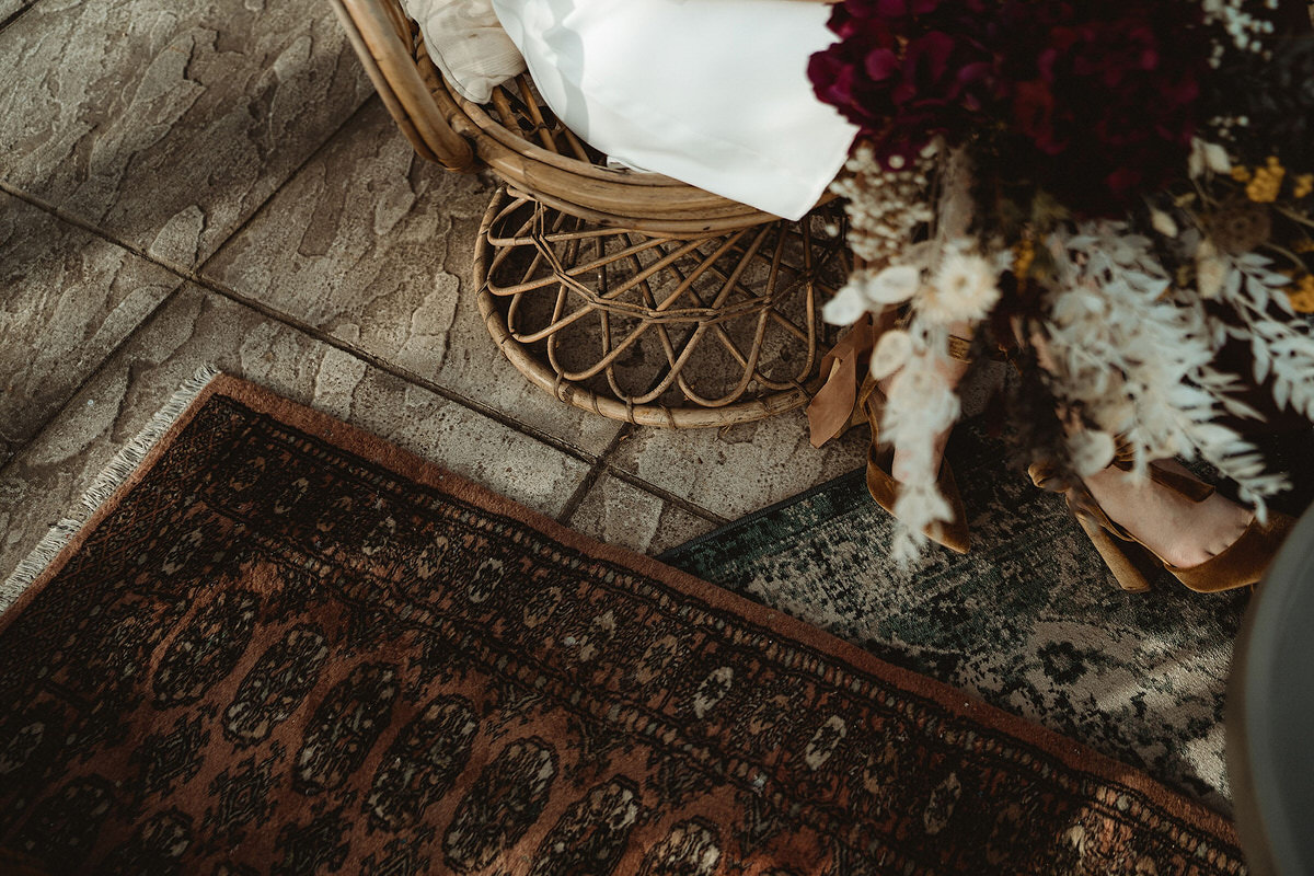 Vintage rug with colourful wedding bouquet