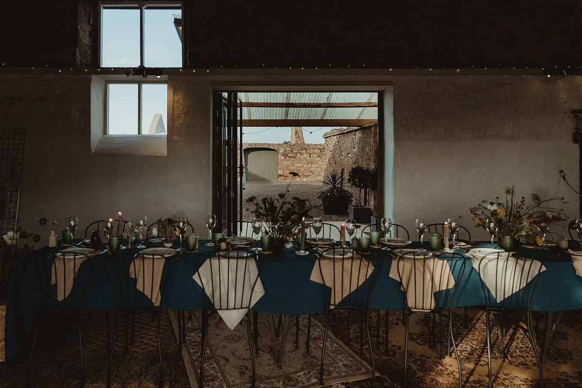 Mini micro small wedding table styling and decoration on long dining table with metal chairs