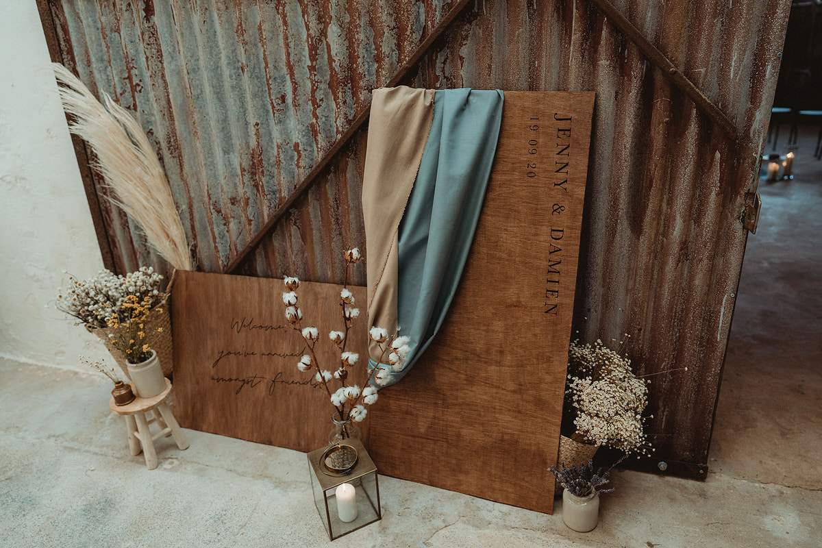Wooden wedding layered welcome sign with draped fabric and dried flowers Small Wedding Scotland Inspo