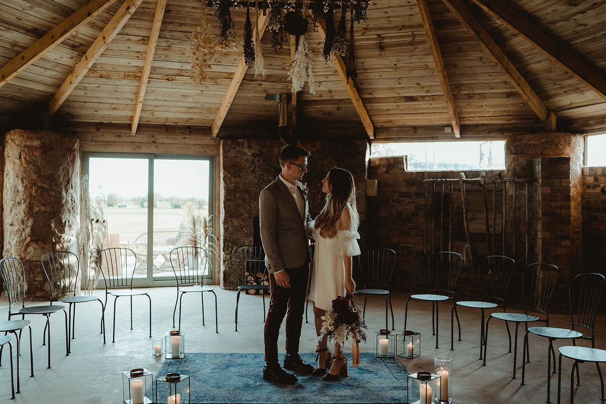 Mini micro small wedding ceremony with blue rug, candles in lanters, metal seating and hanging dried flowers Small Wedding Scotland Inspo