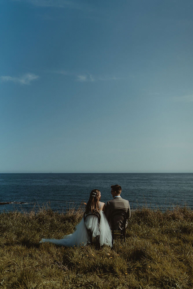 Chairs looking out to sea clifftop seaside elopement on the East Coast of Scotland at The Cow Shed