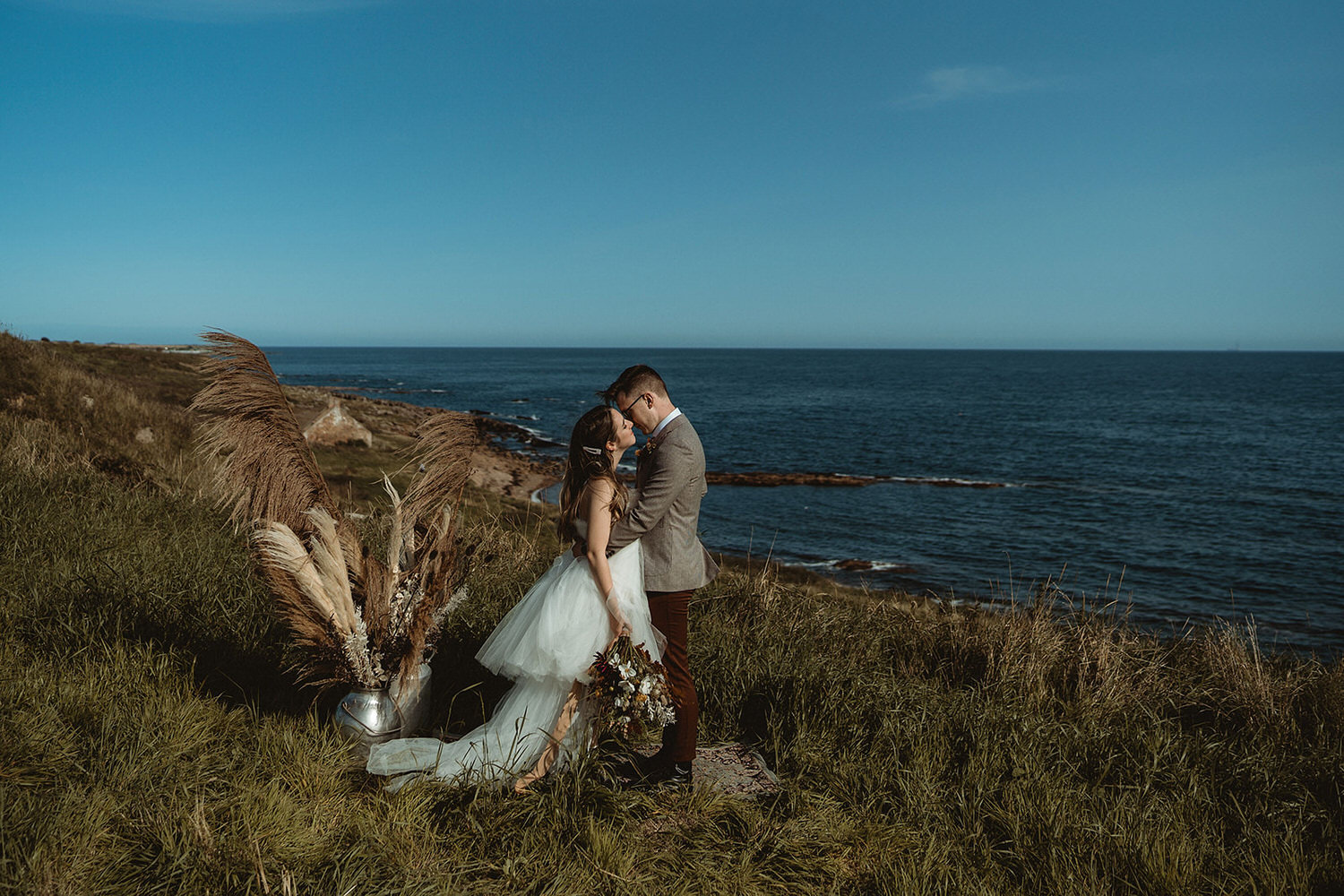 Ceremony set up for clifftop seaside elopement in Scotland