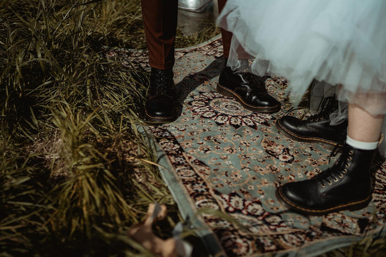 Vintage rug ceremony set up for seaside clifftop elopement