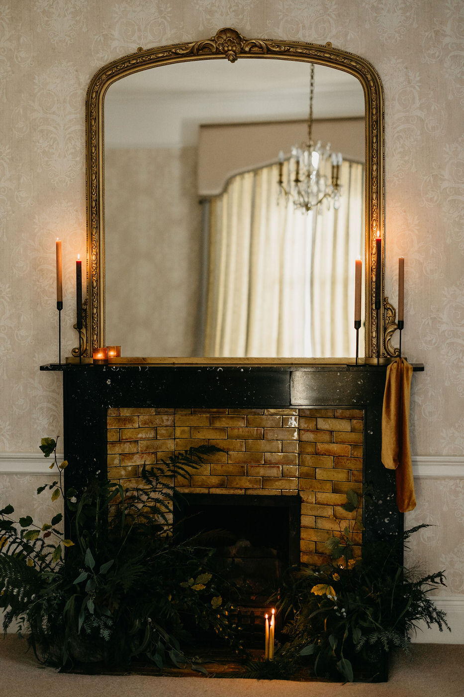 Mantelpiece with candles in traditional Scotland wedding venue