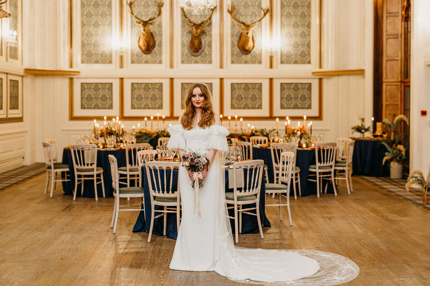 Bride in main hall with dinner tables